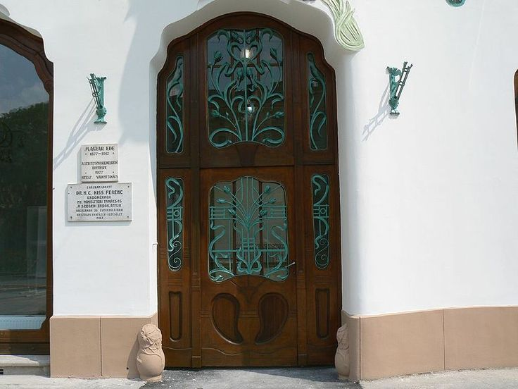 Art Nouveau door with wrought iron grille. — Reök Palace in Szeged, Hungary.