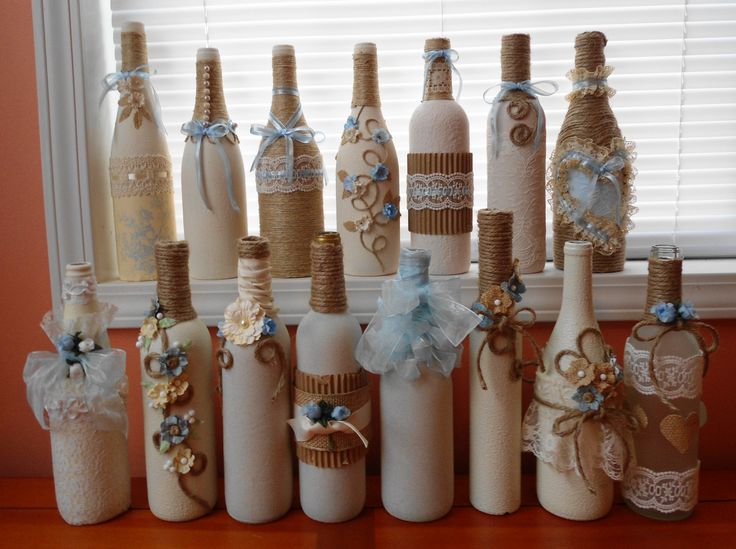 Bottles I made for my Niece's wedding.  Burlap, pale blue, cream and white.  Jute, water distressed flowers, lace, and bling.