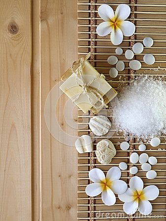 Soap,shells,stones and tiare flowers on the wooden background