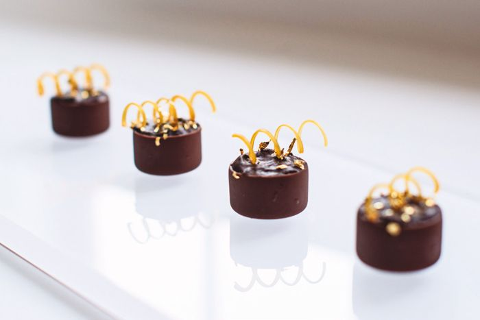 Lindsey Shaw Catering in Toronto recommends serving dark chocolate tarts, made with pumpkin mascarpone and spun sugar spirals, as tray-pass... Photo: Emma Mcintyre for BizBash