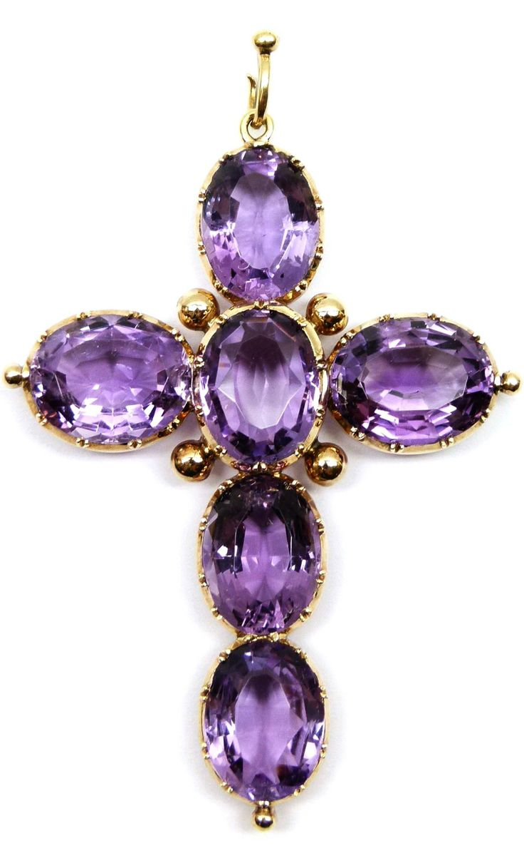 19th century amethyst and gold cross pendant, c.1870 , formed of six oval faceted stones, each in open cut-down collet mounts
