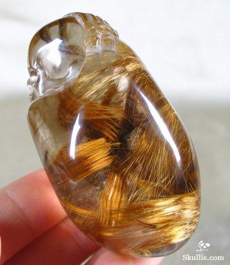 Rutilated quartz. That's crazy it looks like a lock of hair. I've never seen rutilated quartz like that before.