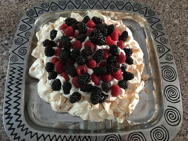 Delia Smith's pavlova! So easy to make and delicious with fresh whipped cream and summer fruit!