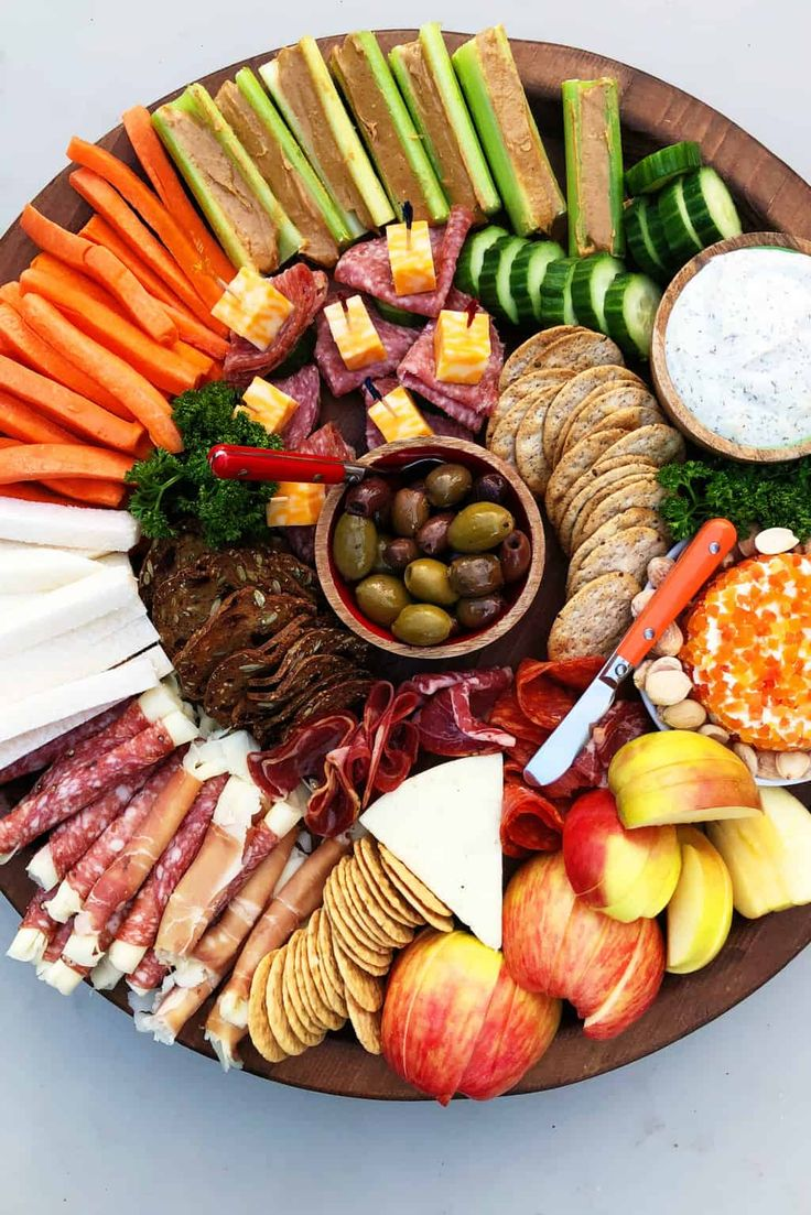 Holiday KidFriendly Charcuterie Board, mixing together