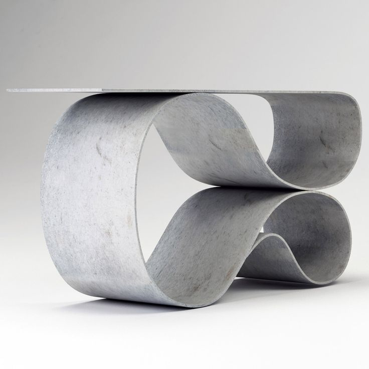 Flexible concrete cloth has made possible the swooping shapes of this console designed by Portland-based Neal Aronowitz.