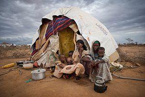 Dadaab camp, Kenya: Habiba Ibrahim Iftin by tent Dadaab camp, Kenya