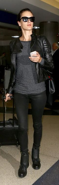 Who made Alessandra Ambrosio's black leather handbag, leather jacket, and ankle boots?