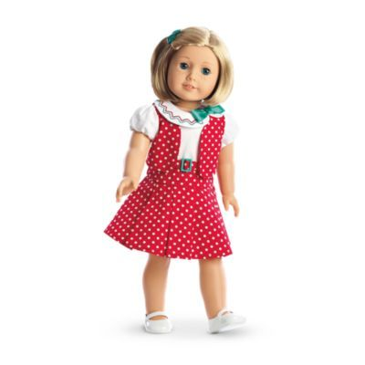 Kit's Reporter Dress-   Kit wears this outfit when she's hot on the trail of a big news story! It includes:      A pretty polka-dot dress, featuring puff sleeves, a Peter Pan collar, and a ribbon bow     A matching vest     White Mary Jane shoes     A green barrette Z