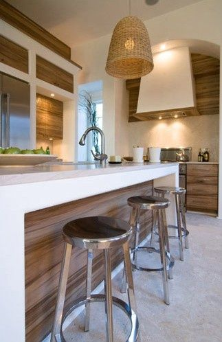 White walls, white bench-tops with timber-grain cupboard fronts.