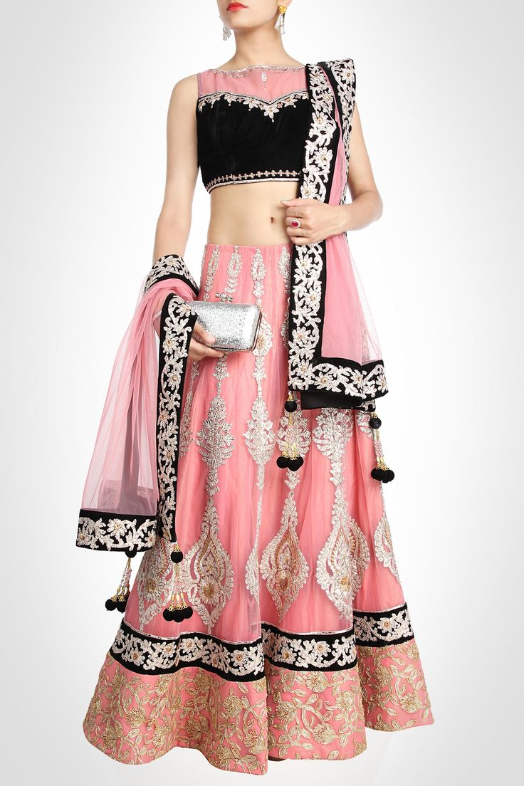 Manish Chotrani collection | Lehenga - This pink lehenga is intricately embroidered and appliquéd in baroque motifs. The gorgeous hem is spruced with gold toned tilla work in scrolling patterns. The hints of black on the blouse and borders, enriched with tilla work spice up the look.