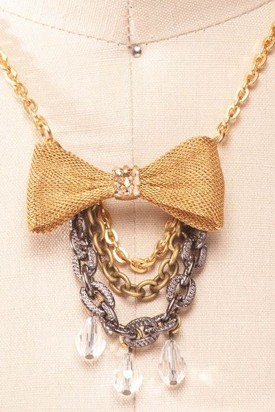 Stardust - Tarina Tarantino golden bow and chains necklace