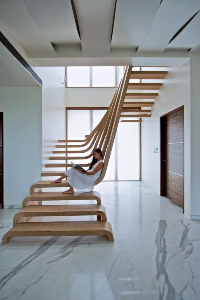 Sculptural Staircase Defines A Modern Two-Storey Apartment In Mumbai