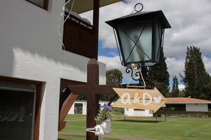 Lighthouse + wooden sign initial bride and groom name letters, to show the way to the ceremony place