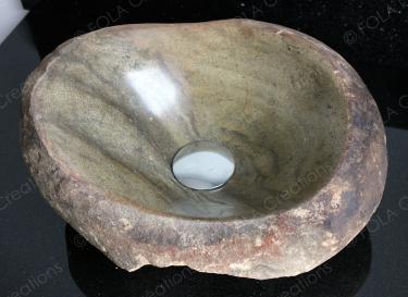 cool natural river boulder hand made into a bathroom sink