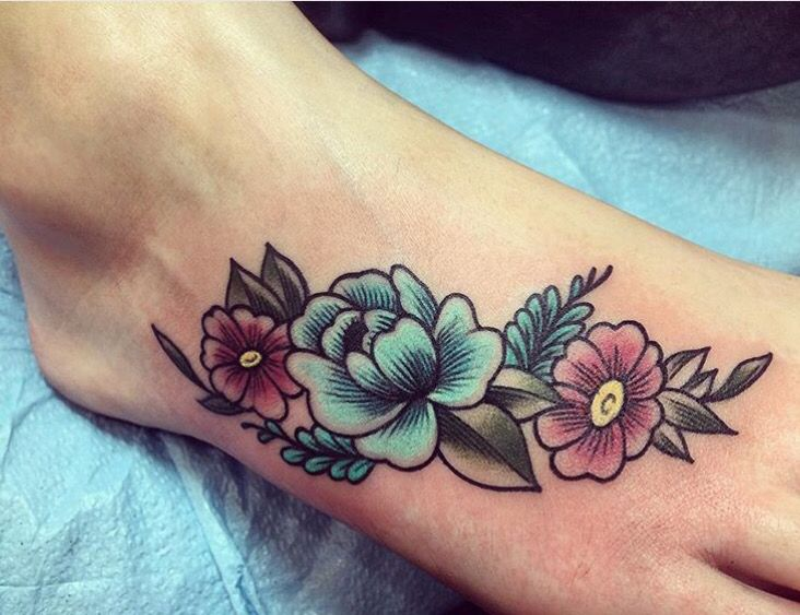 Flower foot tattoo