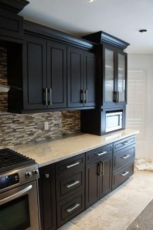 Love the espresso maple cabinets with the back splash