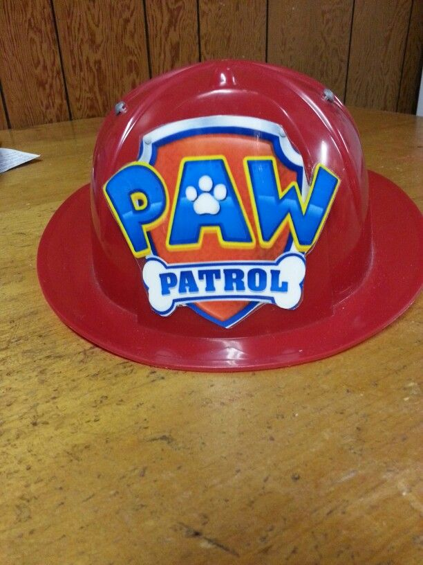 Dollar Tree fireman hat decorated with Pawl Patrol taken Nick Jr and glued on