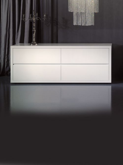 Perfection in minimal design. The Diva Collection White Lacquered Chest of Drawers or Sideboard is truly versatile. Striking in any setting, the ultimate in a stylish and glamorous storage solution. As comfortable in a dining room, bedroom or study as it is as a welcome in an entrance hallway.