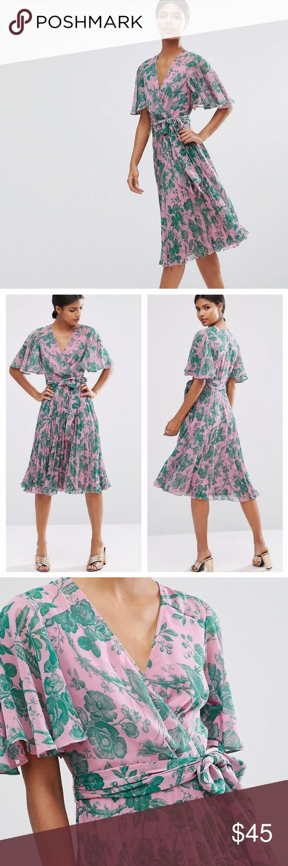 """ASOS Spring Print Pleated Midi Dress Beautiful ASOS Collection Dress. Lined woven fabric. V-neckline, wrap front, wide cut sleeves. Tie waist, knife pleat skirt. Fabric: polyester. Like new, worn once, no flaws. All reasonable offers are welcome! Please make all offers through the offer button🤗 Measurements: bust: 16.5"""" (33) waist: 13.5"""" (27) length: 45"""" ASOS Dresses Midi"""
