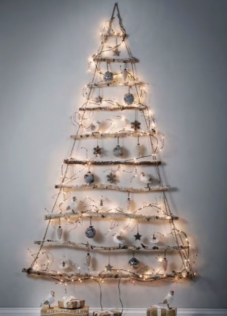 Style your home with wooden Christmas Decorations. Have a small home? This Cox and Cox hanging tree will still bring the wow factor to your living room. Hang cork and bark baubles and a sprinkling of white lights to complete the look.
