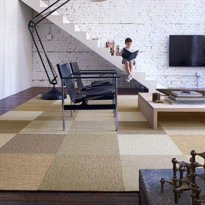 Flor carpet squares.  Cover up ugly carpet or make a custom rug.  Love the mix of neutrals.