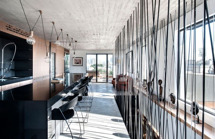 Penthouse Apartment in Tel Aviv by Toledano Architects // Designed by locally based architects Toledano Architects this 160-square metre stunning duplex penthouse apartment and surrounding 80-square metre timber-clad roof terrace renovation in Tel Aviv Israel provides a light-filled contemporary home for...