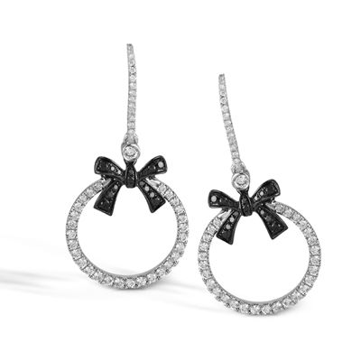 These striking 18K white and black earrings are comprised of .73ctw round white ...