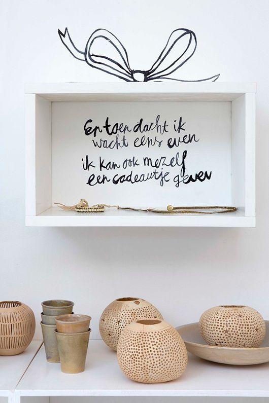 sukha amsterdam. I like the writing on the wall inside the cube. via SF Girl by Bay