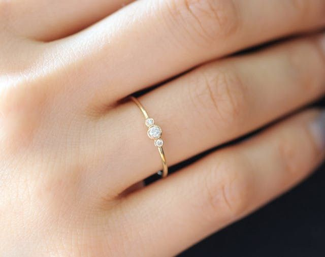 I'm starting to think it's a very sneaky secret that an engagement ring doesn't have to destroy your wallet to be the perfect companion to a marriage proposal