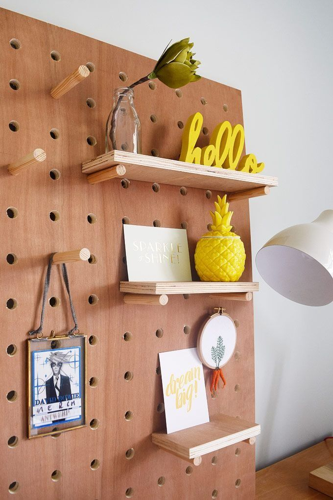 Follow this step by step tutorial to make your own giant DIY Pegboard! It's an easy DIY project and is great for displaying personal items!