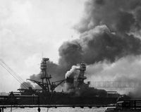 Machine guns on battleship NEVADA open fire on torpedo planes approaching her port beam...two planes hit...however one missile tears huge hole in ship's port bow...