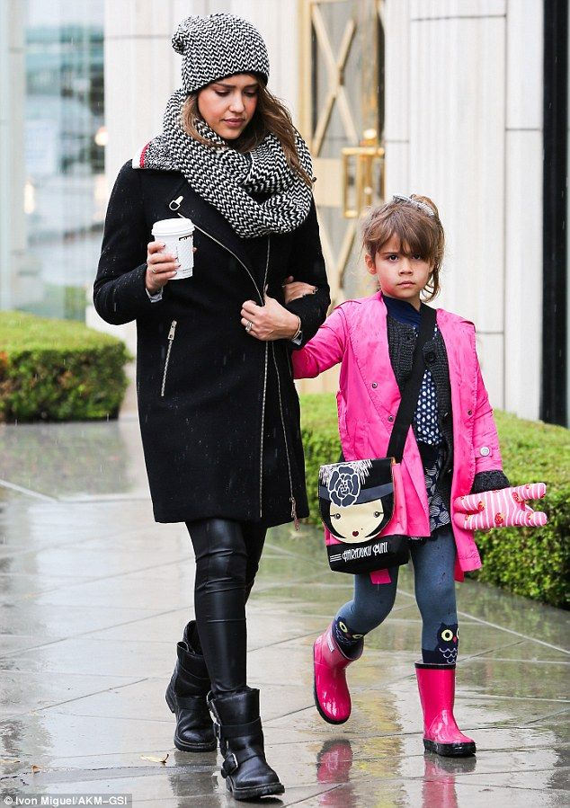 Family time! Jessica Alba had her winter woolies down pat with a matching scarf and beanie as she headed out for a stroll in Los Angeles wit...
