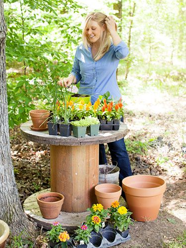 Outdoor use for a large wooden spool. These are often left for garbage - seldom returned for recycling - so why not put them to use? Great in the garden as a rustic potting table.