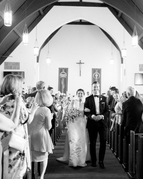 "The traditional Catholic ceremony was held in the afternoon at the St. Bartholomew Catholic Church—Taylor's childhood church in her hometown of Bethesda, Maryland. The couple lit a unity candle to represent their two families becoming one while a vocalist sang Andrea Bocelli's ""The Prayer"". Before the wedding, Father John Enzler asked the couple how they knew they were perfect for each other and read their answers as his homily. Taylor's favorite moment of the entire day was exchanging ..."