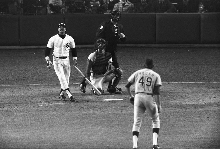 Reggie Jackson watches his third home run -- on three swings -- against the Dodgers in Game 6 of the 1977 World Series. (AP)