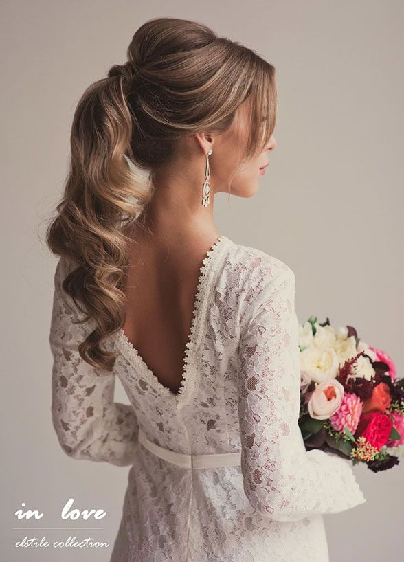 11 Effortlessly Romantic Wedding Hairstyles: A ponytail is anything but plain when you tease at the crown, wrap the holder, and curl the ends. Hair by Elstile