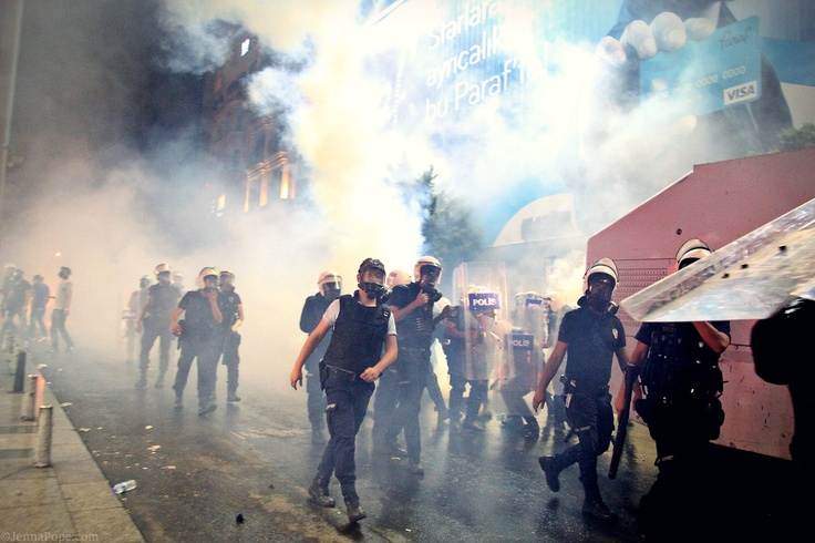 Saturday night in Beyoglu, from Jenna Pope's photoblog (@BatmanWI): Police coming back from a round of teargas attack on protesters.