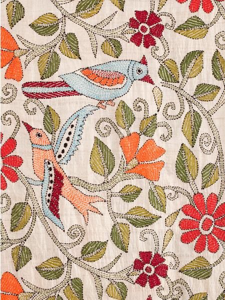 The Birds Scarf is handmade by the women of Self Help Enterprises in India using the Kantha stitching technique, a centuries-old running stitch used for joining layers of fabric. This stylish scarf is