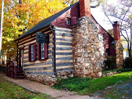 Hand hewn square cut log cabin western hand hewn for Hewn log cabin kits