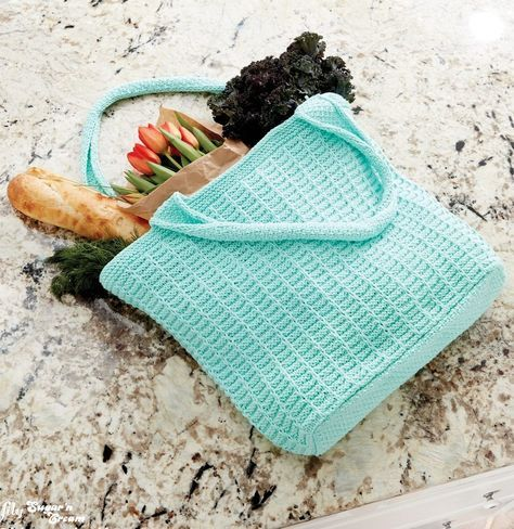 Free Knitting Pattern for Easy 4-Row Repeat Market Tote - Easy textured tote bag with knit straps from Yarnspirations features a 4-row repeat stitch pattern. Approx 19″ [48 cm] wide x 16″ [40.5 cm] high, excluding straps.