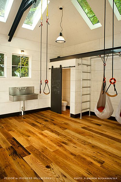 Reclaimed chestnut flooring bring warmth to a garage converted to play room on the West Coast.