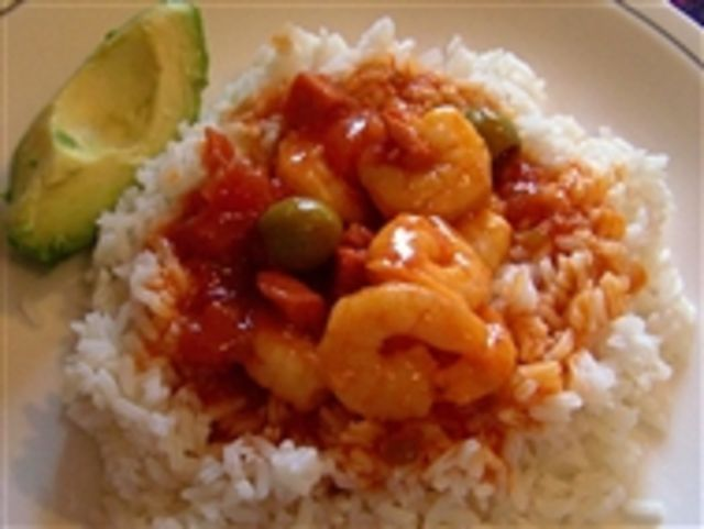 Be amazed by the speed and ease of this Puerto Rican shrimp recipe - delicious shrimp stewed in a tomato based sauce and ready in less than 30 minutes.