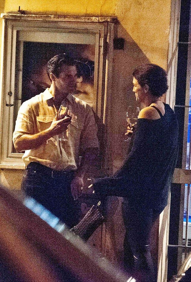 Henry Cavill and Gina Carano cozy date in Rome.. Fr Daily Mail U.K