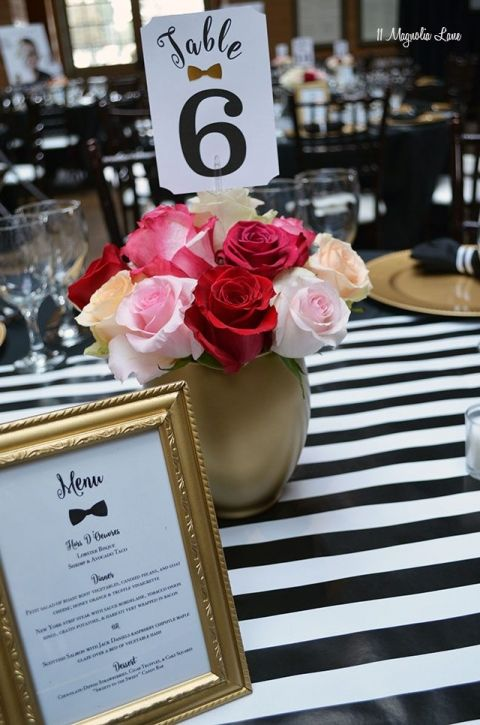 The tables will have numbered table cards and photo of a Harlem Renaissance person.