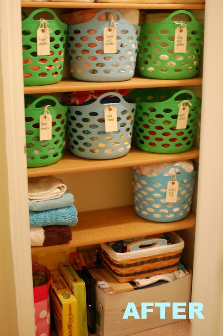 All you need to do to make your life way easier is invest in a few plastic baskets. Here, labels on handles organize linens by size.