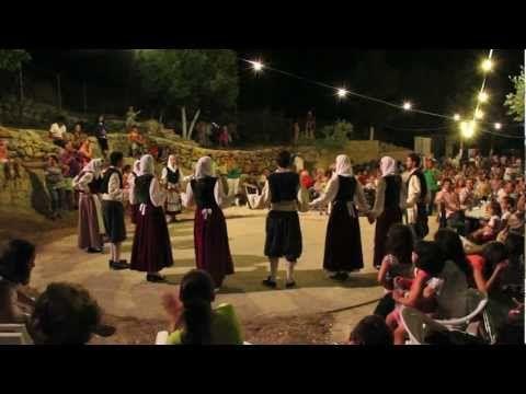 Traditional Greek Music And Dance Night, Kefalonia Island, Greece. Men wear black vests with black or no trim, dark blue vraka.