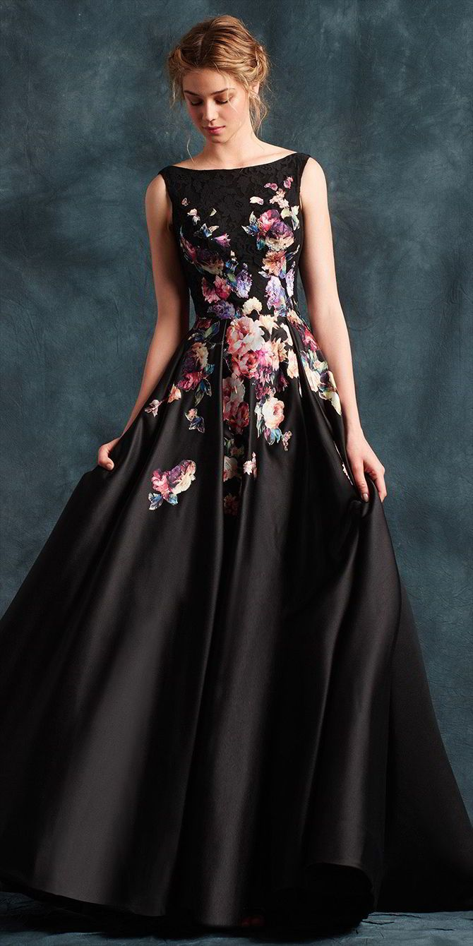 Ball gown dress with Sabrina neckline to the front and V-neckline to the back. Featuring an elegant lace bodice and luxurious duchesse satin skirt with inverted pleat detail, pockets and floral laser-cut motifs.