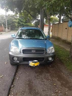 Used Hyundai Santa Fe for sale in Heredia, Costa Rica - Price: $ 7,140 USD - Year: 2003 - Mileage: 150 000 km - Transmission: Automatic - Fuel type: Gasoline - Traction: front-wheel drive - Color: Blue