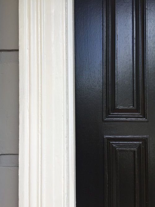 Hello Colour | The perfect exterior combination; contemporary grey facade with crisp white trim and stunning black door.