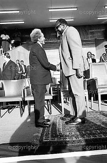Emperor Haile Sellassie I with Idi Amin of Uganda.